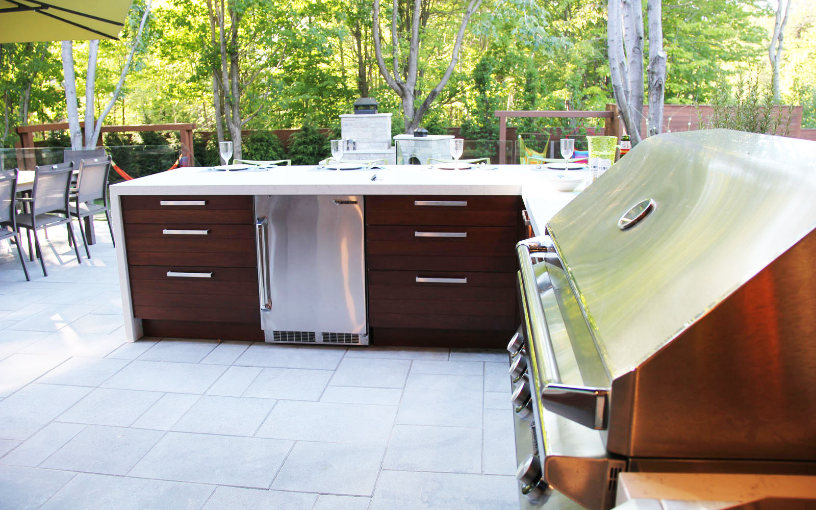 Level hard surface outdoor floor under a cooking station in the backyard