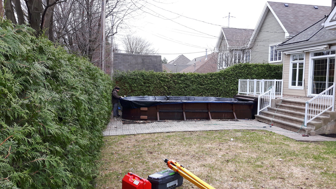 Step 1 for the backyard spa: removing the pool and lawn