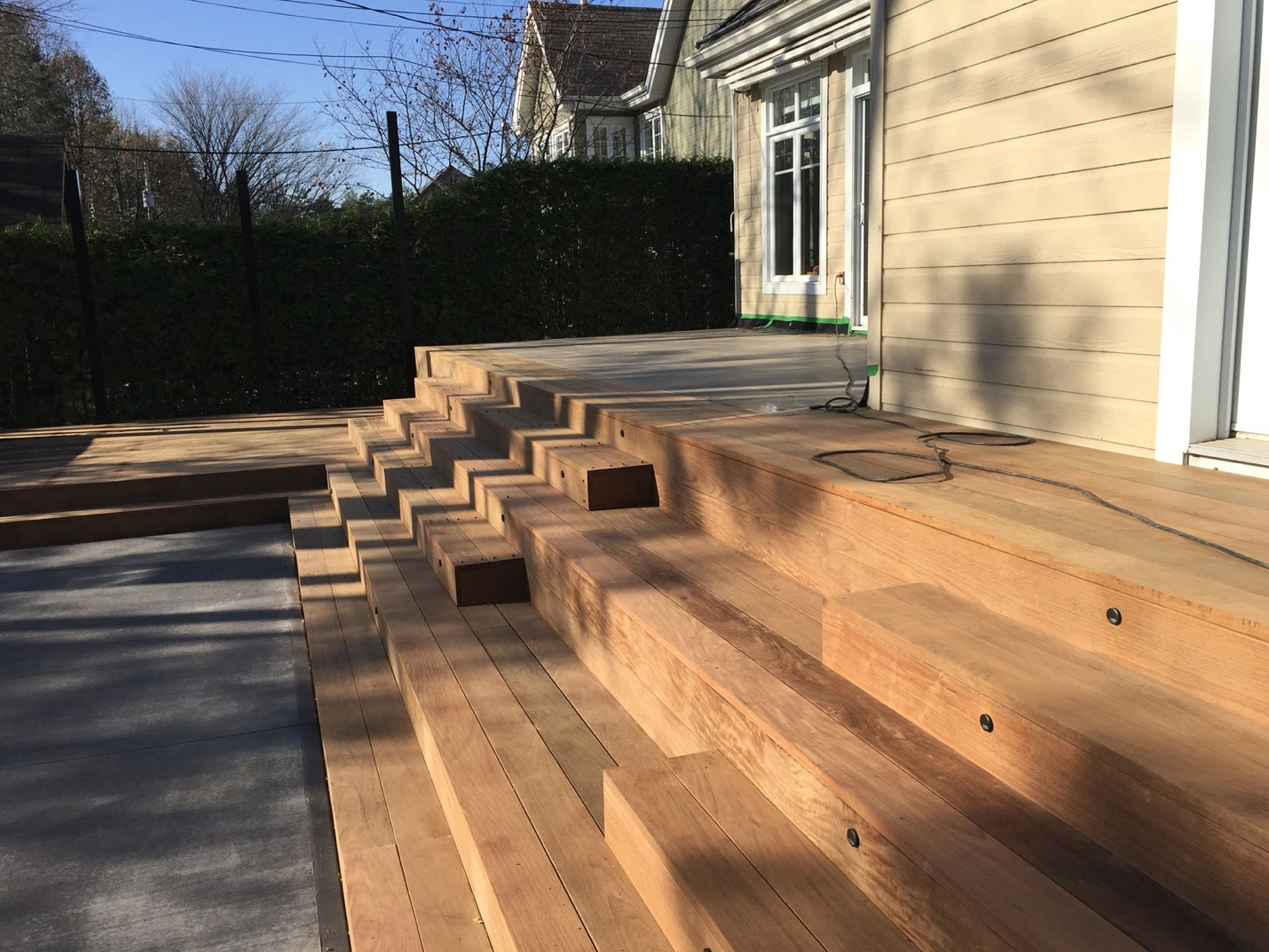Step 4 for the spa deck: building the new deck with Brazilian walnut